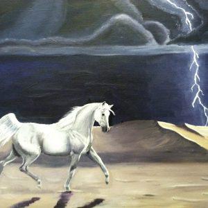 white Arabian horse prancing across the desert in a dark storm and lightning